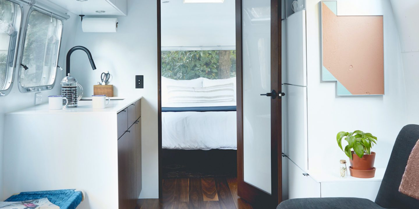 Airstream-interior-bedroom-and-couch-kitchen