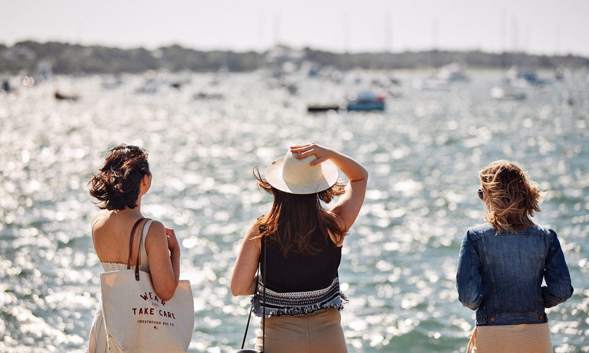 Three-women-looking-at-the-bay